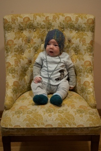 Two months old in the booties Katie made and the hat Adria made- oh so cute!
