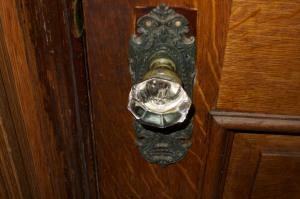 Notice no screws holding it to the door